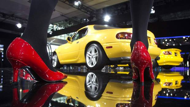 A Mazda MX-5 as it is reflected in the shiny ground at the Jacob Javits Convention Center during the New York International Auto Show in New York April 16, 2014. The fourth-generation roadster will have Mazda's SKYACTIV system, making it lighter and stronger, claims Mazda. (CARLO ALLEGRI/REUTERS)