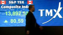 An employee passes a stock board at the Toronto Stock Exchange. (Kevin Van Paassen/Kevin Van Paassen/The Globe and Mail)