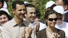 Syrian President Bashar al-Assad and his wife Asma visit an environmental garden during the opening of the Jasmine Festival, in central Damascus, in 2007. (Bassem Tallawi/Associated Press/Bassem Tallawi/Associated Press)