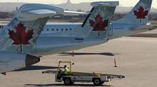 Air Canada planes sit on the tarmac as many baggage handlers walked off the job at Pierre Trudeau airport in Montreal, March 23, 2012. (Ryan Remiorz/The Canadian Press/Ryan Remiorz/The Canadian Press)