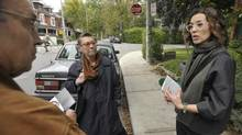 Toronto District School Board Trustee candidate Marcela Saitua speaks with John and Anne VanBurek while canvassing door to door in Toronto's Parkdale this month. (J.P. MOCZULSKI)