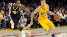 Utah Jazz guard Mo Williams (5) grabs Los Angeles Lakers guard Steve Nash (10) shirt as he gets by him during the first half of an NBA preseason basketball game, Saturday, Oct. 13, 2012, in Los Angeles. (Gus Ruelas/The Associated Press)