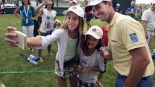 Mike Weir takes time out from his Pro-Am duties at the RBC Canadian Open to pose for a selfie with Kaylee Chin and Maya Cunningham (Ryan Remiorz/The Canadian Press)