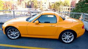 Chick cars really do exist, and the 2011 Mazda MX5 defines the genre - the orange MX5 looks like a rolling Smartie, so cute it hurts.