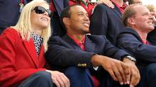 Tiger Woods and his wife Elin Nordegren at the winner's award ceremony at the Presidents Cup golf compeititon in this Oct. 11, 2009 file photo at Harding Park Golf course in San Francisco, California. (ROBYN BECK/ROBYN BECK/AFP/Getty Images)
