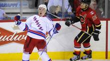 New York Rangers' Ryan McDonagh (L) celebrates his overtime game winning goal in front of Calgary Flames' Jarome Iginla during their NHL hockey game in Calgary, Alberta, October 20, 2011. (TODD KOROL/REUTERS)