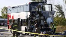Emergency workers take a person away on a stretcher at the scene of an accident involving a bus and a train in Ottawa September 18, 2013. (CHRIS WATTIE/REUTERS)