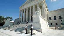 The U.S. Supreme Court in Washington is currently divided into factions of four Republican judges and four Democratic judges. (YURI GRIPAS/REUTERS)