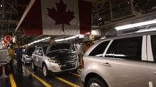 Vehicles on the assembly line at Ford Motor Co. of Canada's Oakville plant. A troubling trend in auto maker investment is beginning to raise questions about the medium- and long-term health of an industry that contributes 1.5 per cent of Canada's gross domestic product directly, and much more when the spinoff benefits it generates are included. (Fred Lum/The Globe and Mail)