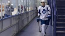 Toronto Maple Leafs Dave Bolland makes his way onto the ice for a practice in Toronto (Chris Young/THE CANADIAN PRESS)