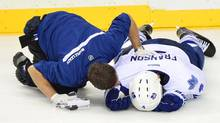 Toronto Maple Leafs defenceman Cody Franson (4) is attended by a trainer after an injury against the Nashville Predators during the third period at Bridgestone Arena. (Don McPeak/USA Today Sports)