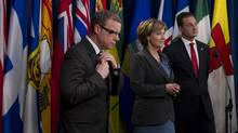Saskatchewan Premier Brad Wall, left, along with fellow premiers Christy Clark of B.C. and Robert Ghiz of PEI are starting an Innovation Working Group to tackle challenges in the health care system. (JONATHAN HAYWARD/THE CANADIAN PRESS/JONATHAN HAYWARD/THE CANADIAN PRESS)