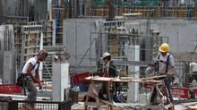 Construction work being done on a condominium construction site at Bathurst Street and Fork York Blvd. in Toronto on May 29, 2012. (Deborah Baic/Deborah Baic/The Globe and Mail)