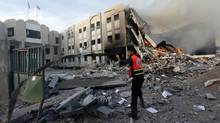 A Palestinian firefighter prepares to extinguish a fire after an Israeli air strike on the building of the Hamas ministry of interior in Gaza City, Nov. 16, 2012. (Mohammed Salem/REUTERS)