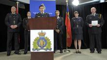 RCMP Chief Inspector Larry Tremblay announces the arrest of Qing Quentin Huang of Toronto under the Security of Information Act, during a news conference with members of York Regional Police, the OPP and Toronto Police on Dec. 1, 2013. (J.P. MOCZULSKI FOR THE GLOBE AND MAIL)