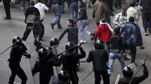 Egyptian protesters flee as riot police charge towards them in Cairo, Egypt, Friday, Jan. 28, 2011. (Victoria Hazou/Victoria Hazou/AP)