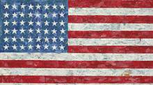 """This undated photo provided by Christie's auction house shows Jasper Johns' """"Flag,"""" a pop art rendition of the American flag created in the 1960s that author Michael Crichton bought from the artist in 1973. (Christie's/AP)"""