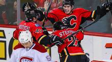 Calgary Flames centre Sean Monahan (23) celebrates his goal with teammates against the Montreal Canadiens during the first period at Scotiabank Saddledome. (SERGEI BELSKI/USA TODAY SPORTS)