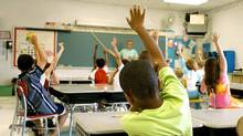 Teacher and kids in classroom (Nancy Louie/iStockphoto)