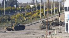 Syrian tanks are seen in Bab Amro near the city of Homs Feb. 12, 2012. (Reuters/Reuters)
