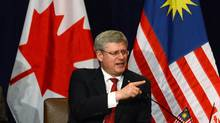 Prime Minister Stephen Harper takes part in a business round table in Kuala Lumpur, Malaysia, on Saturday, October 5, 2013. Harper will travel to the APEC Leaders' Meeting in Bali, Indonesia, following his state visit to Malaysia. (Sean Kilpatrick/THE CANADIAN PRESS)