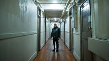 Jack Gates stands in a hallway at the single-room-occupancy Regent Hotel in the Downtown Eastside of Vancouver, B.C. Gates is part of a group of tenants who have filed a lawsuit targeting the City of Vancouver alleging officials failed to ensure the owners of the building kept it safe for human inhabitation