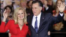 Mitt Romney and his wife Ann wave as they leave a rally in Schaumburg, Ill., after winning the Illinois Primary on March 20, 2012. (Nam Y. Huh/AP)