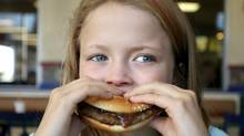 Child eating hamburger (Jonathan Barnes)