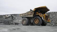 Miners work at an Agnico-Eagle operation. (Sean Kilpatrick/THE CANADIAN PRESS)