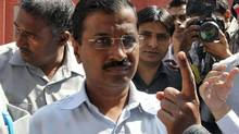 Arvind Kejriwal, the leader of the anti-corruption Aam Aadmi Party (AAP), shows his ink-marked finger after casting his vote outside a polling station in New Delhi April 10, 2014. Around 815 million people have registered to vote in the world's biggest election which concludes on May 12. (VIJAY MATHUR/REUTERS)