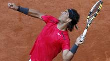 Rafael Nadal of Spain serves to Simone Bolelli of Italy during the French Open tennis tournament at the Roland Garros stadium in Paris May 29, 2012. (NIR ELIAS/Reuters)