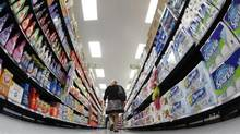 A shopper walks down an aisle in a Walmart store in Chicago in September, 2011. (Jim Young/REUTERS)