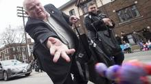 Toronto Mayor Rob Ford tosses chocolate eggs to the crowd as he walks in the Beaches Easter Parade in Toronto on Sunday March 31, 2013. (Chris Young For The Globe and Mail)