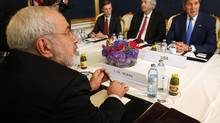 """Iran's Foreign Minister Javad Zarif (L) holds a bilateral meeting with U.S. Secretary of State John Kerry (R) on the second straight day of talks over Tehran's nuclear program in Vienna, July 14, 2014. Kerry will press his Iranian counterpart Zarif to make """"critical choices"""" in a second straight day of talks over Tehran's nuclear program on Monday, a U.S. official said. REUTERS/Jim Bourg (AUSTRIA - Tags: POLITICS ENERGY) (JIM BOURG/REUTERS)"""