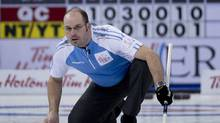 Quebec skip Jean-Michel Menard watches his shot during the afternoon draw against Northwest Territories/Yukon at the Tim Hortons Brier in Edmonton on Sunday, March 3, 2013. / (Jonathan Hayward/THE CANADIAN PRESS)