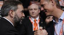 Adam Giambrone and federal NDP Leader Thomas Mulcair shake hands at the party's leadership convention in Toronto March 24, 2012. (Fred Lum/The Globe and Mail)