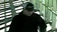 Toronto Police released this closed-circuit video image of an alleged attacker, who is white, aged 25 to 30, weighing about 180 pounds, unshaven with short brown hair. He was wearing a baggy black winter jacket, beige pants, a beige baseball hat worn back to front, construction boots and black sunglasses. (Toronto Police Service)