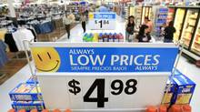 Price signs are shown at a Wal-Mart store in a Las Vegas file photo from May 16, 2006. (JAE C HONG/AP)