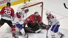 Chicago Blackhawks goalie Corey Crawford (50) makes a save on Montreal Canadiens center David Desharnais (51) during the second period at the United Center in Chicago on Sunday, Jan. 17, 2016. (David Banks/USA Today Sports)