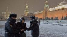 Interior Ministry members detain a gay rights activist attempting to hold a protest rally in Red Square near the Kremlin in central Moscow, Feb. 7, 2014. Russian police detained gay rights activists who tried to protest on Moscow's Red Square and in St Petersburg on Friday, shortly before Vladimir Putin opened the Sochi Winter Olympics, gay rights activists said. (STRINGER/REUTERS)