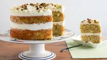 Top the layer cake with a crown of vanilla bean buttercream and a sprinkling of chopped or ground pistachios. (Stephanie Eddy For The Globe and Mail)