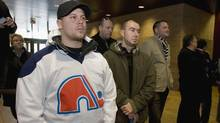 Dave Edward, a Quebec Nordiques fan, stands with others at a press conference with Quebec City mayor Regis Labeaume to announce his engagement to build a new arena, potential home for a new NHL team, October, 2009 in Quebec City. (Jacques Boissinot/The Canadian Press)