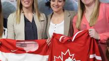 Canada national women's team members Meghan Agosta-Marcino, Haley Irwin, middle, and Sarah Vaillancourt were on hand Monday in Ottawa for the world championship roster unveiling. (FRED CHARTRAND/THE CANADIAN PRESS)