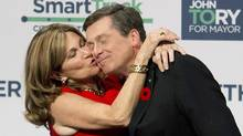 John Tory, right, receives a kiss from his wife Barbra Hackett after winning the election and becoming the new mayor of the City of Toronto in Toronto on Monday, October 27, 2014. (Nathan Denette/THE CANADIAN PRESS)