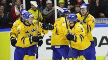 Sweden's Alexander Wennberg, left, his goal with teammate Andreas Johnson, right, during the IIHF World Junior Championship preliminary round group B icehockey match between Sweden and Finland at Malmo Arena in Malmo, Sweden, on Dec. 28, 2013. (LUDVIG THUNMAN/AP)