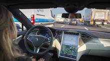 An employee drives a Tesla Motors Inc. Model S electric automobile, equipped with Autopilot hardware and software, hands-free on a highway in Amsterdam, Netherlands, on Monday, Oct. 27, 2015. Tesla started equipping the Model S with hardware -- radar, a forward-looking camera, 12 long-range sensors, GPS -- to enable the autopilot features about a year ago. (Jasper Juinen/Bloomberg)