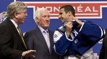 Nazem Kadri of the London Knights shares a laugh with Brian Burke, left, and Cliff Fletcher of the Toronto Maple Leafs as he slips on his jersey at the 2009 NHL entry draft Friday, June 26, 2009 in Montreal. (Ryan Remiorz/The Canadian Press)