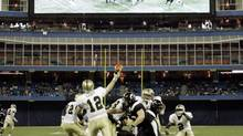 Western Michigan University Broncos quarterback Ryan Cubit (12) throws a pass against the University of Cincinnati Bearcats during the second half of their inaugural NCAA International Bowl football game in Toronto January 6, 2007. REUTERS/Mike Cassese (MIKE CASSESE)