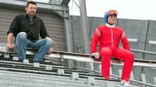 Bronson (Hugh Jackman) and Eddie (Taron Egerton) hope for the best, while expecting the worst, in advance of Eddie's next practice jump. (Larry Horricks/Twentieth Century Fox)