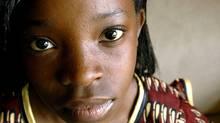 11-year-old Idah, in traditional Malawi dress, in the den of her family's Burlington home. (Sheryl Nadler/Sheryl Nadler)